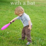 hitting dandelions with a bat