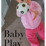 baby play: rolling a ball